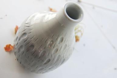 textured celadon bottle.
