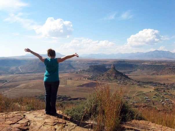 Me, on Thaba-Bosiu, taking it all in. Below is the Qiloane Mountain. Many say that the shape of the mountain is the origin of the iconic Basotho hat.